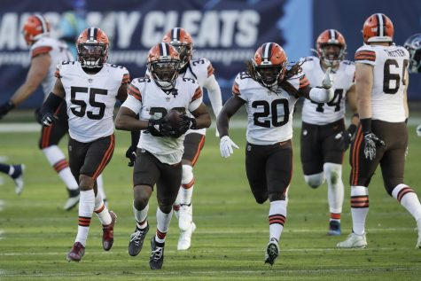"""Cleveland Browns cornerback M.J. Stewart (36) celebrates after intercepting a pass against the Tennessee Titans in the second half of an NFL football game Sunday, Dec. 6, 2020, in Nashville, Tenn. (AP Photo/Ben Margot)"""
