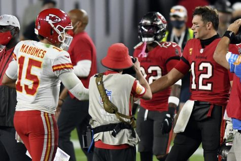 """""""In this Nov. 29, 2020, file photo, Tampa Bay Buccaneers quarterback Tom Brady (12) congratulates Kansas City Chiefs quarterback Patrick Mahomes (15) after their NFL football game in Tampa, Fla. The Super Bowl matchup features the most accomplished quarterback ever to play the game who is still thriving at age 43 in Brady against the young gun who is rewriting record books at age 25. (AP Photo/Jason Behnken, File)"""""""