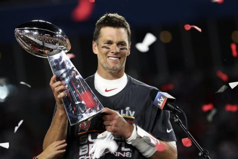 """Tampa Bay Buccaneers quarterback Tom Brady (12) holds the Vince Lombardi trophy following the NFL Super Bowl 55 football game against the Kansas City Chiefs, Sunday, Feb. 7, 2021, in Tampa, Fla. Tampa Bay won 31-9."" (Ben Liebenberg via AP)"