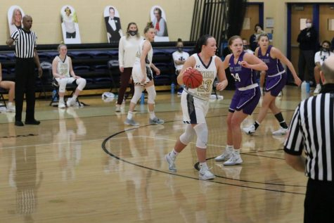 Nicole Heffington (ball in hand) is guarded by a Mount Union defender at the Tony DeCarlo Center on Jan. 29, 2021.