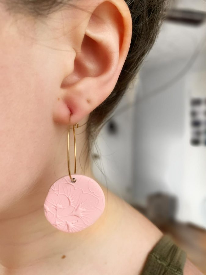 AJ Modernist gold hoops with pink ginkgo design (pictured above).