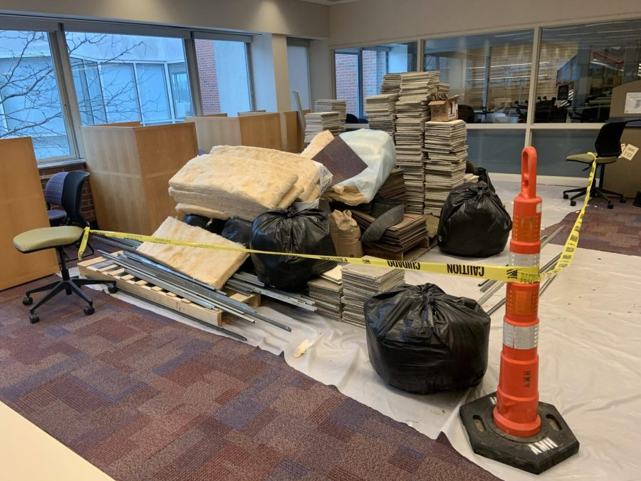 Insulation, ceiling tiles and garbage bags are stored behind caution tape on the third floor. (Photo by Aiden Keenan).