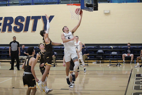 Mason Trubisky leaps forward for a layup in a game against Baldwin Wallace on Feb. 5, 2021, at the Tony DeCarlo Varsity Center.