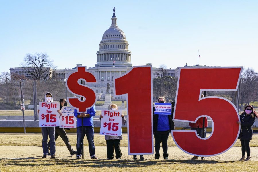 Activists+appeal+for+a+%2415+minimum+wage+near+the+Capitol+in+Washington%2C+Thursday%2C+Feb.+25%2C+2021.+The+%241.9+trillion+COVID-19+relief+bill+being+prepped+in+Congress+includes+a+provision+that+over+five+years+would+hike+the+federal+minimum+wage+to+%2415+an+hour.+%28AP+Photo%2FJ.+Scott+Applewhite%29
