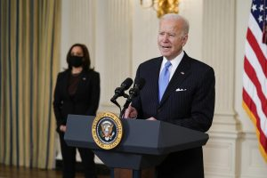 President Joe Biden, accompanied by Vice President Kamala Harris, speaks about efforts to combat COVID-19, in the State Dining Room of the White House, Tuesday, March 2, 2021, in Washington. (AP Photo/Evan Vucci)