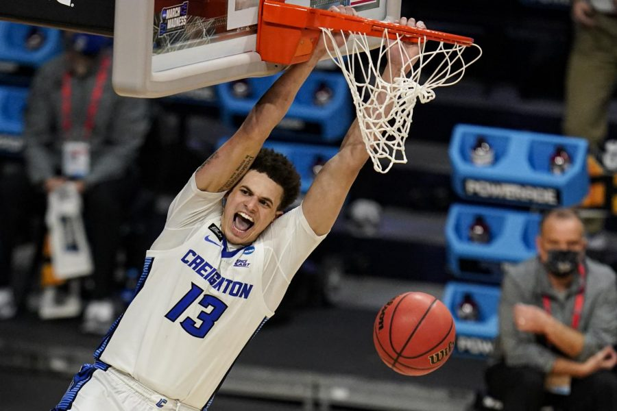 Creighton forward Christian Bishop (13) follows through on a dunk against Ohio in the second half of a second-round game in the NCAA mens college basketball tournament at Hinkle Fieldhouse in Indianapolis, Monday, March 22, 2021. (AP Photo/Michael Conroy)