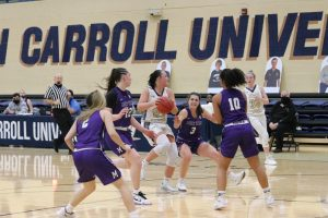 Nicole Heffington ball-in-hand) is surrounded by four Mount Union defenders in a game at the Tony DeCarlo Varsity Center on Jan. 29, 2021.
