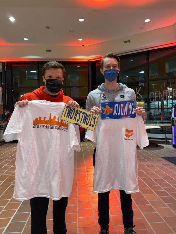 Westin Fishel '22 and Christian Litwinowicz '22 pose with their t-shirts and customized license plates in the atrium of the Student Center.  (Photo courtesy of Emma Kosicek '23).