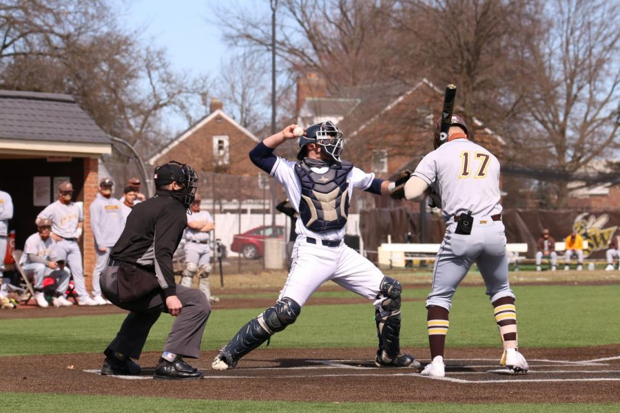 John Carroll University baseball catcher Henry Haracz winds up before throwing out a runner at second base in a game against Baldwin Wallace on Saturday, March 13.