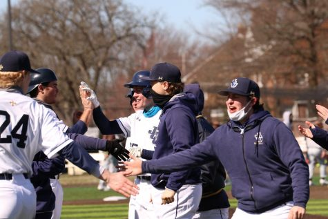 Joe Olsavsky (blue neck gator) celebrates after hitting a walk-off single against Baldwin Wallace on March 13, 2021.