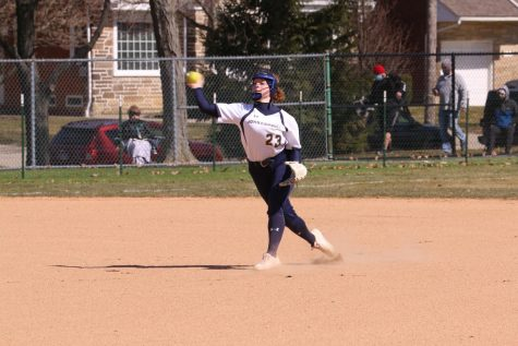 Lauren Sienkiewicz attempts to throw a runner out against Otterbein in a game on March 14, 2021, at Schweikert Field.