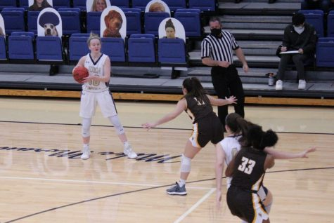 Abby Adler holds the ball in the Ohio Athletic Conference Tournament Championship game against Baldwin Wallace at the Tony DeCarlo Varsity Center on March 6.