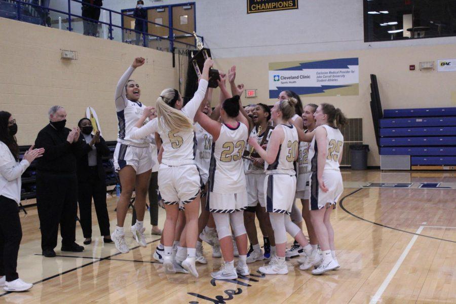 The John Carroll University Women's Basketball Team celebrates after winning the OAC Tournament Championship at the Tony DeCarlo Varsity Center on March 6.