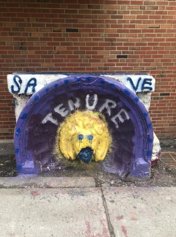 "JCU students graffiti ""SAVE TENURE"" on the lion."