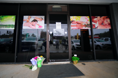 A make-shift memorial is seen outside a business where a multiple fatal shooting occurred on Tuesday, Wednesday, March 17, 2021, in Acworth, Ga.
