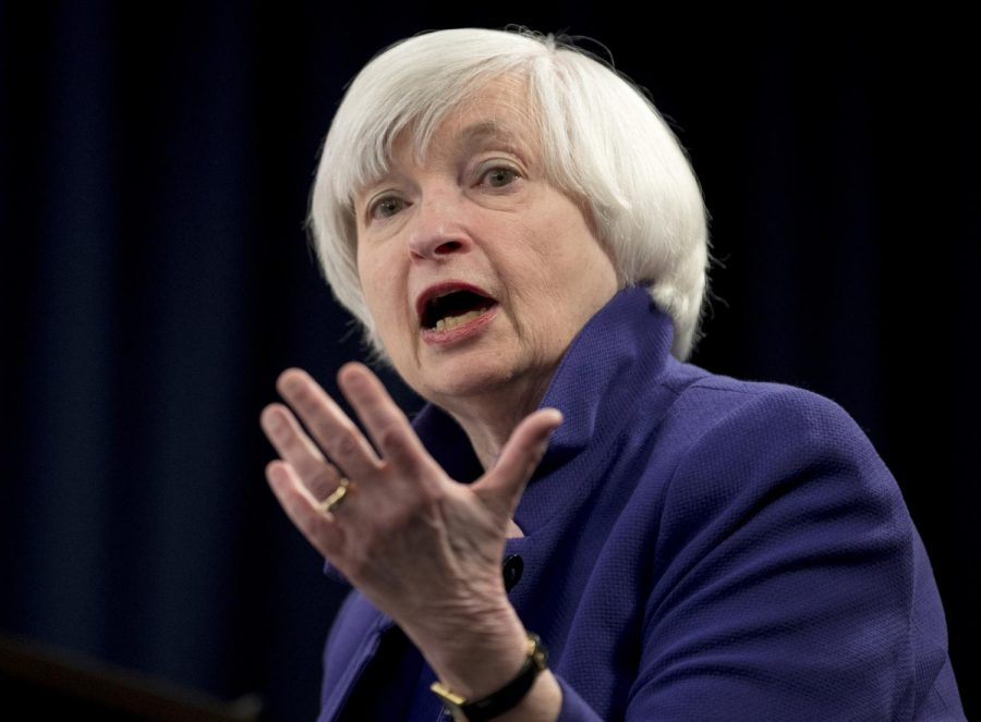 In this Dec. 13, 2017 file photo, Federal Reserve Chair Janet Yellen speaks during a news conference. Yellen on Monday, April 5, 2021, urged the adoption of a minimum global corporate income tax, an effort to offset any disadvantages that might arise from the Biden administration's proposed increase in the U.S. corporate tax rate.