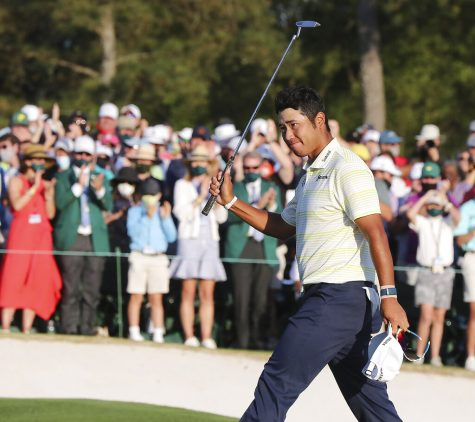 """Hideki Matsuyama, of Japan, celebrates after winning the Masters golf tournament on Sunday, April 11, 2021, in Augusta, Ga. (Curtis Compton/Atlanta Journal-Constitution via AP)"""