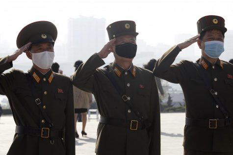 North Korean army officers visit the Mansu Hill on the occasion of the Day of the Sun, the birth anniversary of late leader Kim Il Sung, in Pyongyang, North Korea Thursday, April 15, 2021.