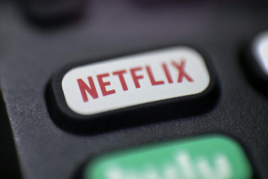 This Aug. 13, 2020 photo shows a logo for Netflix on a remote control.