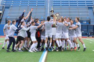 The John Carroll University Men's Soccer Team celebrates after winning the Ohio Athletic Conference Tournament championship against Marietta at Don Shula Stadium on Sunday, April 18, 2021.