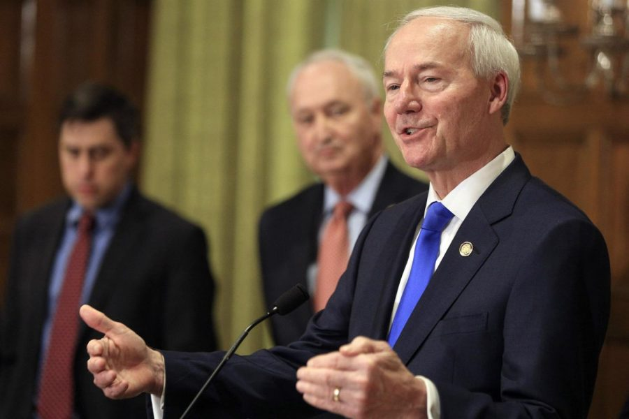 Asa Hutchinson speaks at a daily press conference in Little Rock, Ark., on March 23, 2020.