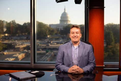 Kyle Kelly sits at the CSPAN news desk in Washington D.C.