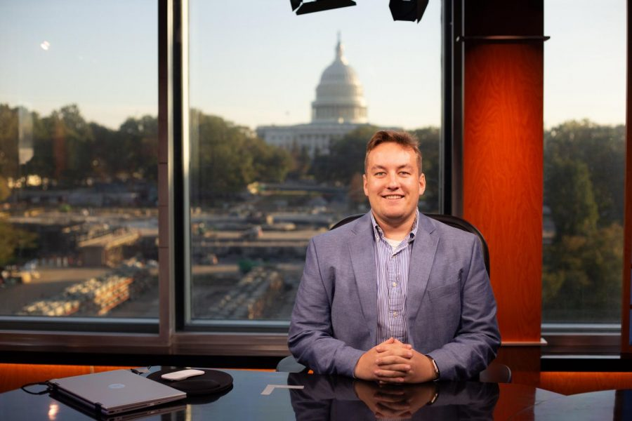 Kyle Kelly sits at the CSPAN news desk in Washington D.C.
