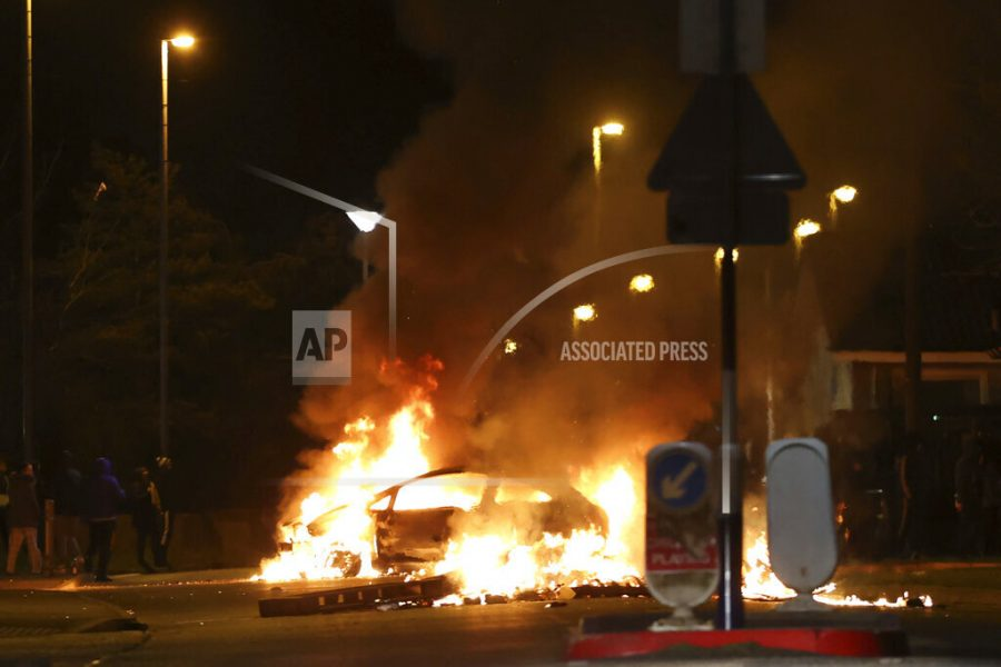 A car burns at Sperrin Park in the Waterside area of Derry in Northern Ireland on Monday April 5, 2021. (Liam McBurney/PA via AP)
