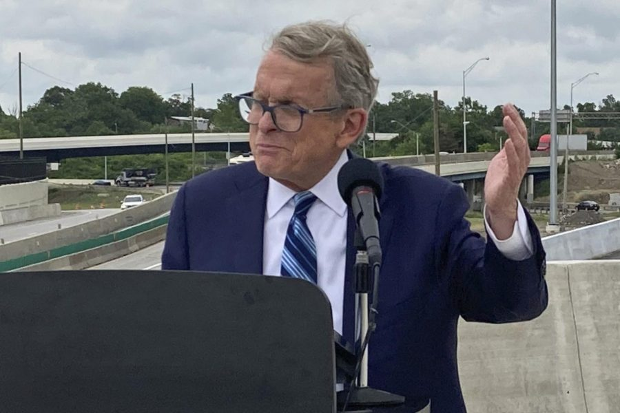 In this July 13, 2021 file photo, Ohio Gov. Mike DeWine promotes a new entrance ramp onto I-70 in downtown Columbus, Ohio. DeWine says Democratic President Joe Biden made a mistake in ordering new federal vaccine requirements.