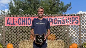 Alex Phillip after winning the All Ohio Championship 8K on Friday, Sept. 17.