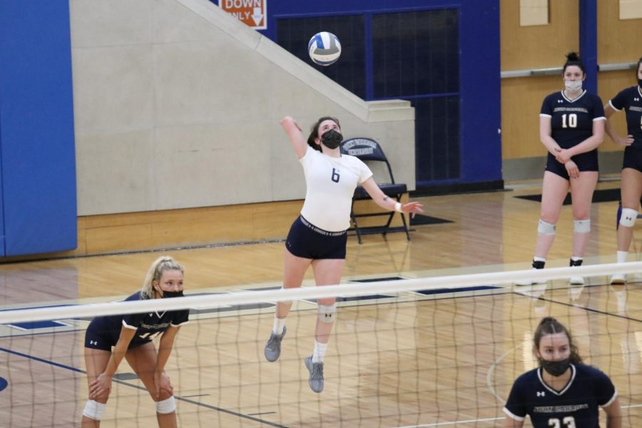 Anna Coughlin serving in a 2021 volleyball match. Coughlin was named to the All-Tournament team over the weekend.