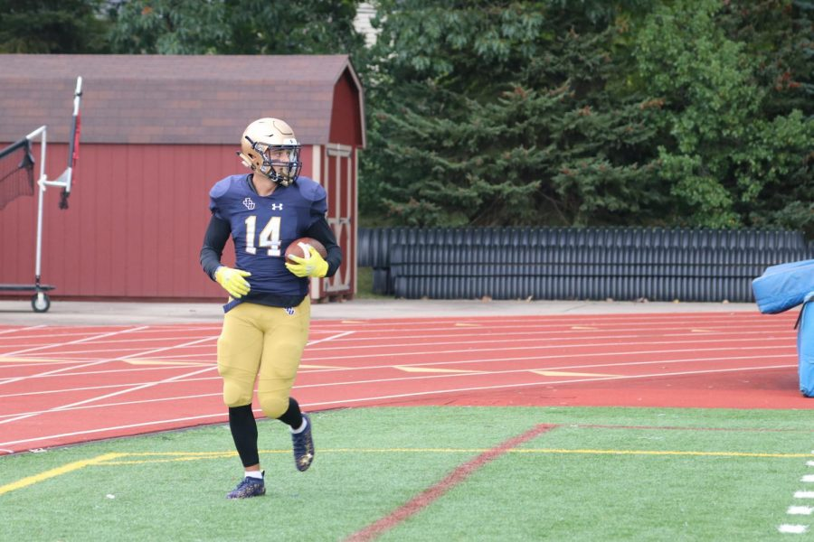 Junior Brennan Fugh scoring a the touchdown in Saturdays loss against the University of Mount Union. Fugh led the team in receiving with two touchdowns and 92 yards.