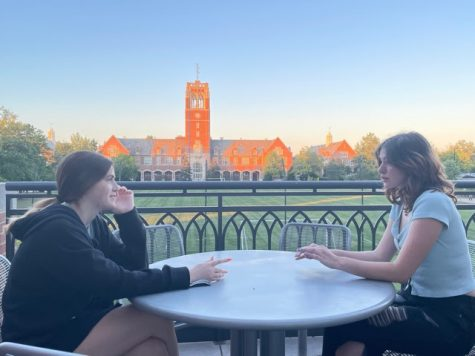 Caroline Padden 25 and Clare Atheneos 25 share a conversation on the balcony of Dolan Science Center.