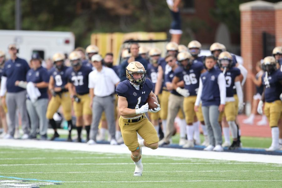 Junior running back Matthew Buser rushing in Saturdays game against Muskingum University. Buser led the team in rushing with 111 yards and two touchdowns in the 29-7 victory.