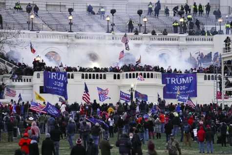 In this Jan. 6, 2021 file photo, violent protesters, loyal to President Donald Trump, storm the Capitol in Washington. A House committee tasked with investigating the Jan. 6 Capitol insurrection is moving swiftly to hold at least one of Donald Trump's allies, former White House aide Steve Bannon, in contempt. Thats happening as the former president is pushing back on the probe in a new lawsuit.