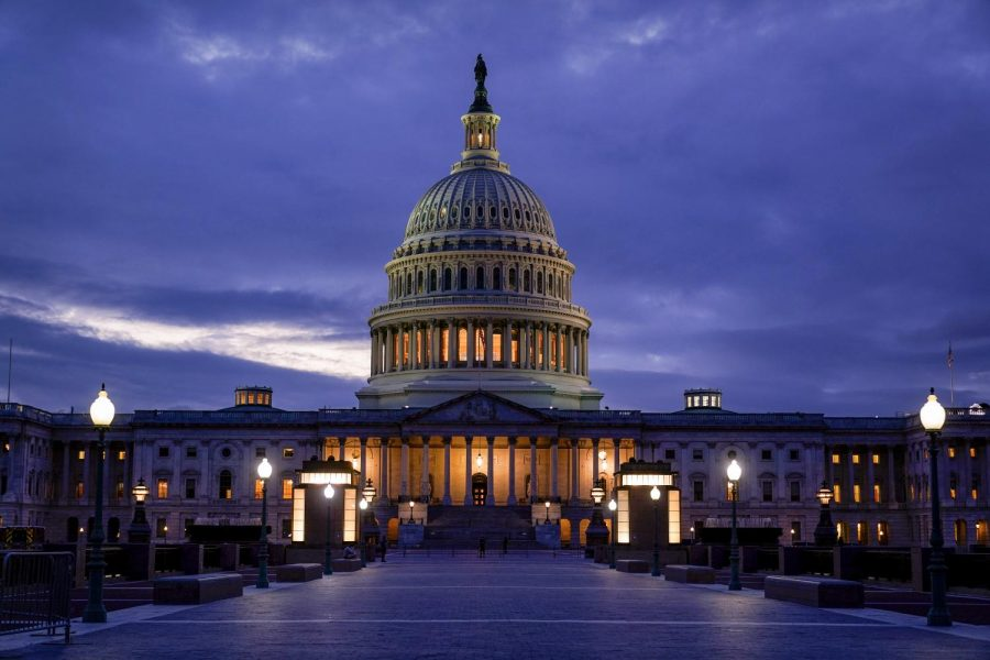 The light in the cupola of the Capitol Dome is illuminated, indicating that work continues in Congress, in Washington, Wednesday, Oct. 6, 2021. Senate Republican leader Mitch McConnell has given Democrats a new offer to extend the federal debt ceiling through an emergency short-term extension.