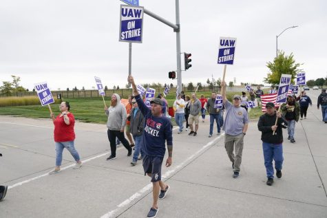Members of the United Auto Workers strike outside of a John Deere plant, Wednesday, Oct. 20, 2021, in Ankeny, Iowa. About 10,000 UAW workers have gone on strike against John Deere since last Thursday at plants in Iowa, Illinois and Kansas.