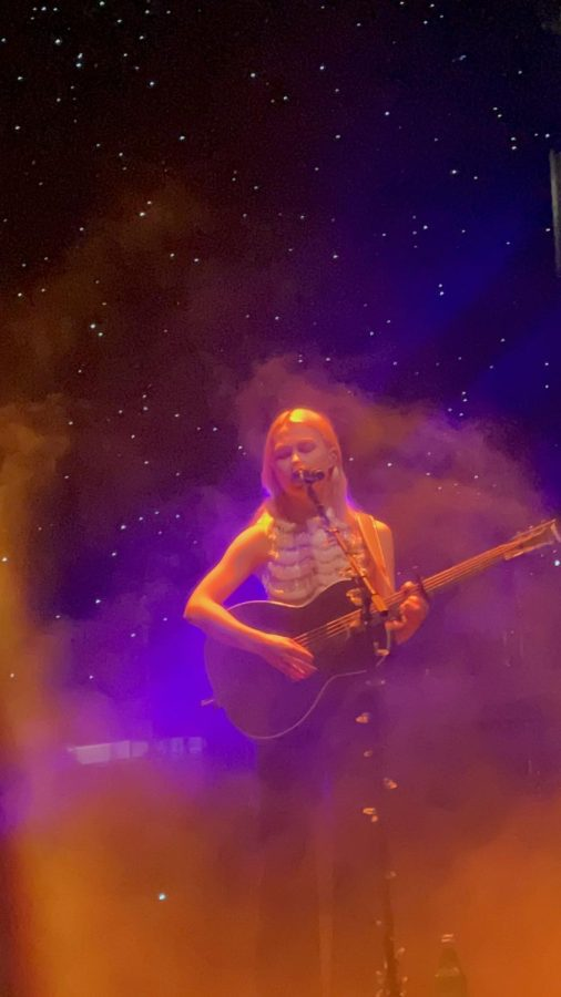 Phoebe Bridgers playing her guitar, her signature instrument, during the Cleveland show of the Reunion Tour.