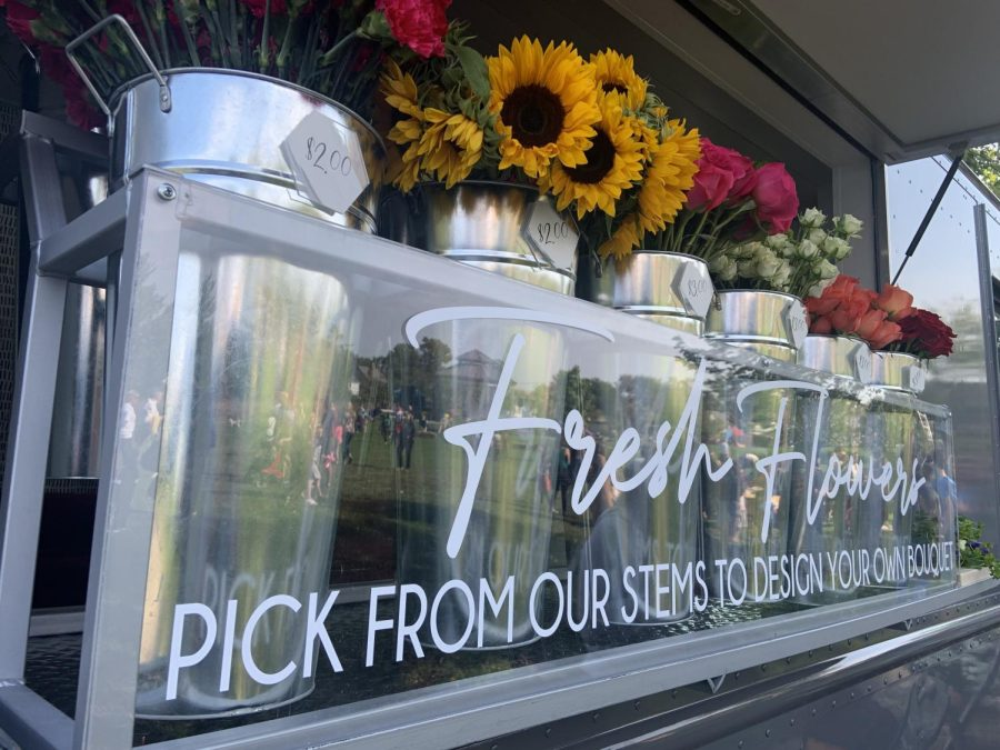 Bloom Big Stem Bar displayed their flowers from this glass shelf on the front of their truck. (Photo by Aiden Keenan).