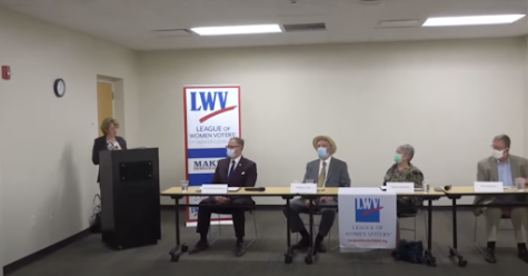 Deanna Fisher introduces the candidates. From left to right, Michael Dylan Brennan, Phil Atkins, Barbara Blankfeld, and Ken Simmons.